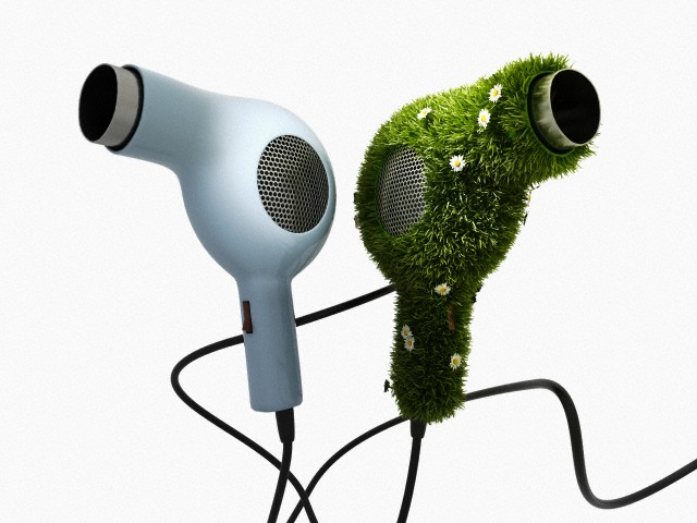 pair of hairdryers, one with grass surface